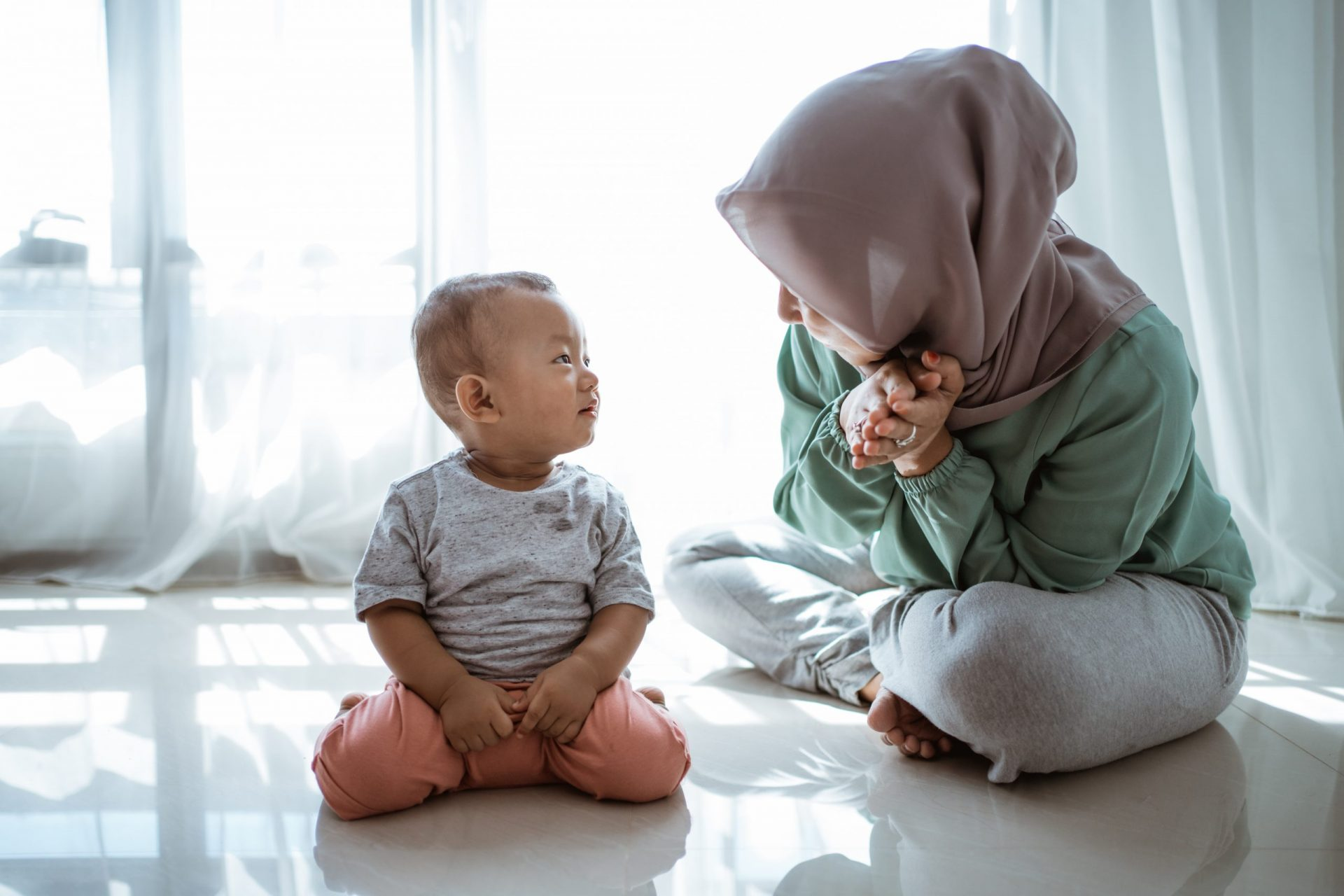 muslim mother and son having conversation at home